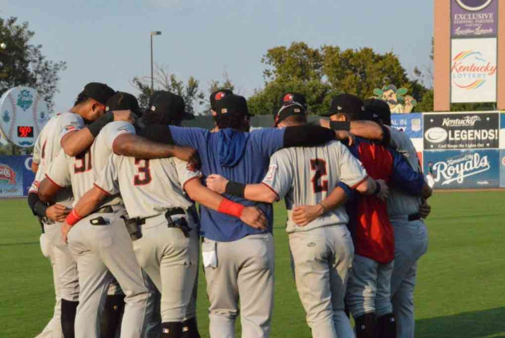 Hickory Crawdads huddling before a Championship game